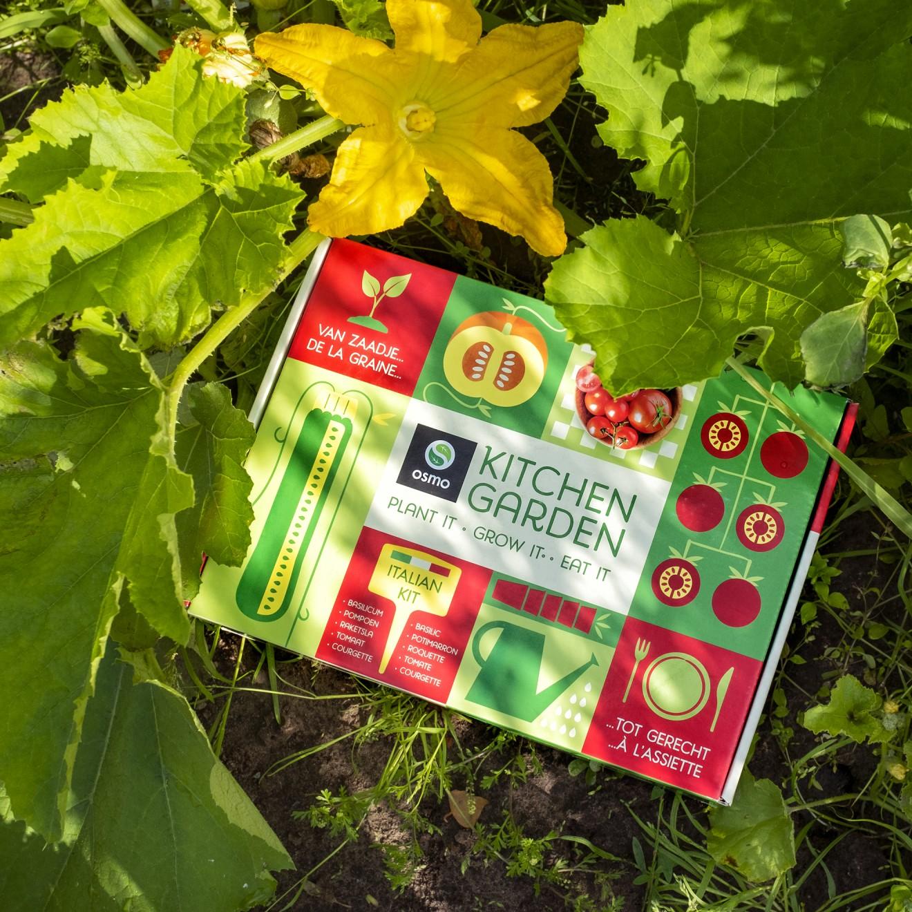 Quatre Mains package design - box, courgette, tomato, soil
