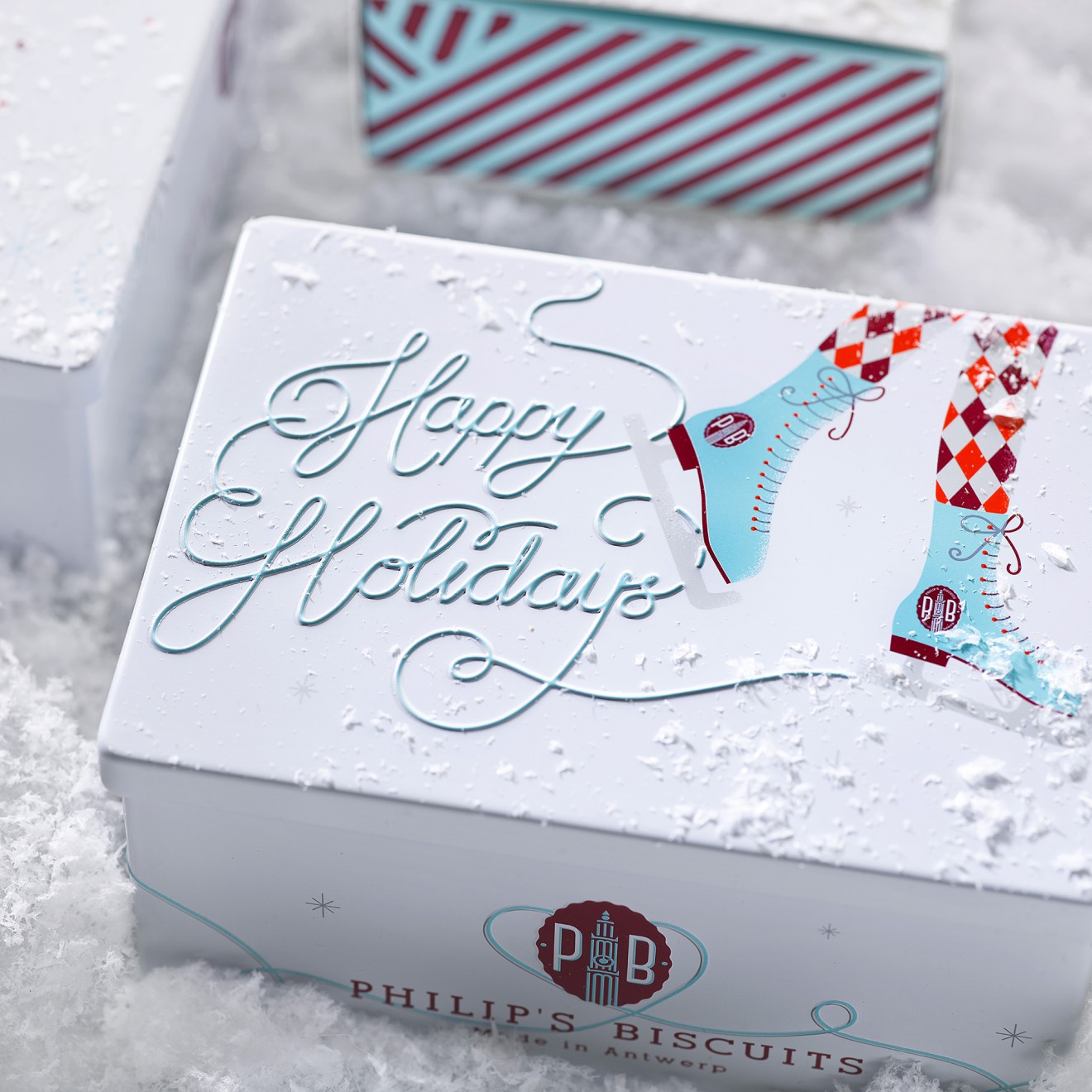 Quatre Mains package design - tin, christmas, packaging design
